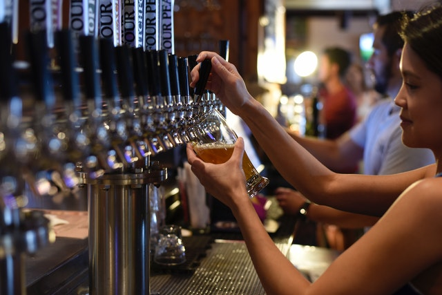 pouring beer in pub